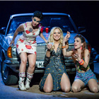Rhian Lois (Frasquita), Justina Gringyte (Carmen) and Clare Presland (Mercedes) in Bizet's CARMEN at the London Coliseum. Photo by Alastair Muir